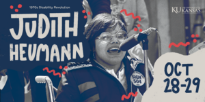 """A young Judy Heumann speaks at a microphone outside. She wears octagonal glasses and a button on her jacket that reads """"sign 504."""" There is a mix of typed and drawn text on top of the image that reads """"1970's Disability Revolution, Judith Heumann,"""" on the left and """"Oct 28-29"""" and the KU signature on the right."""