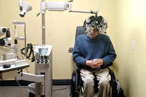 Bob Mikesic trying out eye testing equipment
