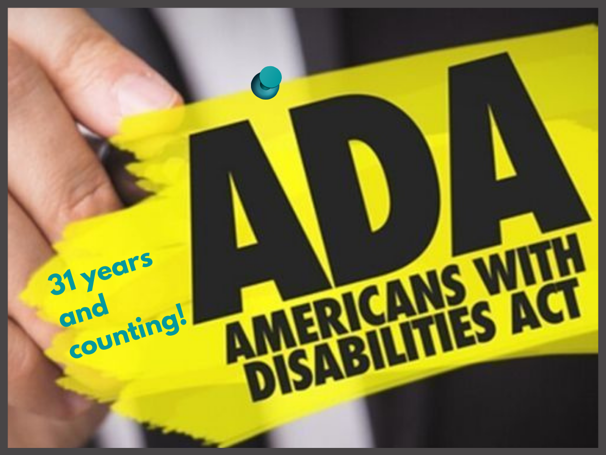 closeup of hand holding highlighter and highlighting the words ADA Americans With Disabilities Act, 31 years and counting